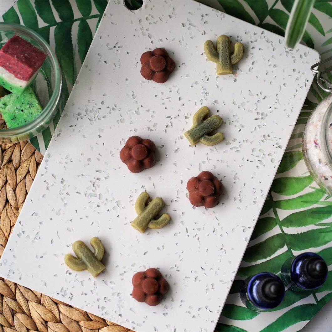 No more itchy, dry legs! Make your own non greasy lotion bars with simple, all natural and vegan ingredients. These travel size massage bars are perfect for hot Summer days.